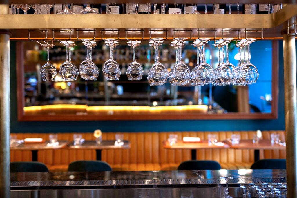 Glasses hanging at bar