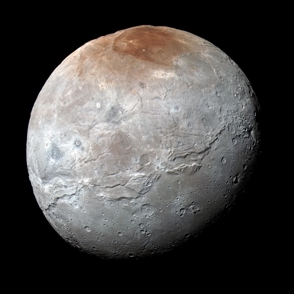 The Mystery Behind Pluto's Snow-Capped Mountains