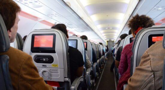 Passengers Sitting On Flight