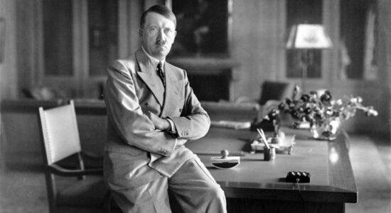 Adolf Hitler Sitting On Desk