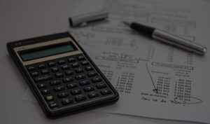 calculator doing numbers   Lift CPA Accounting Vancouver