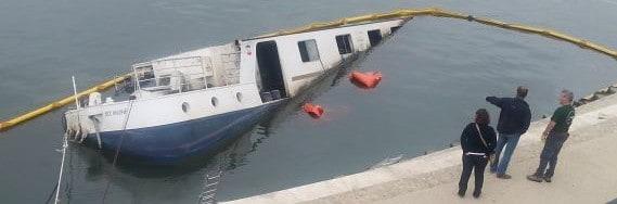Sinking boat in Arles, France