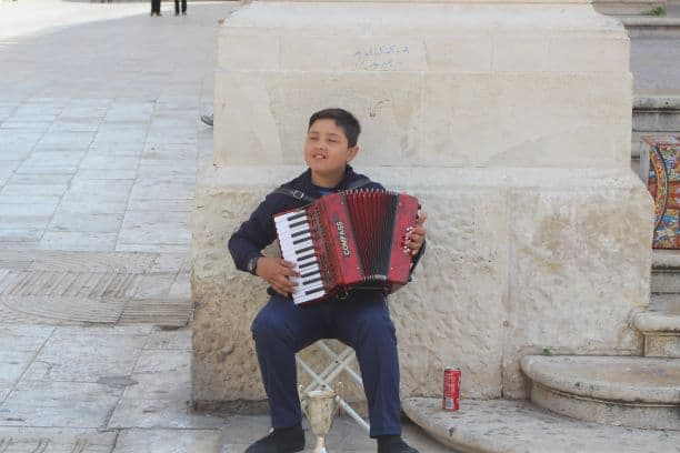 Our young friend playing accordion near the steps of the cathedral (Photo: Brent Petersen)