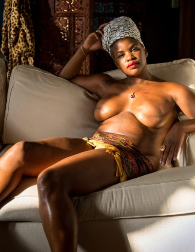 Ericka Hart on a white couch