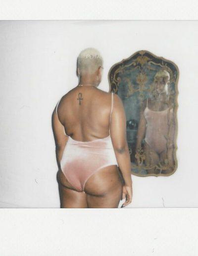 Ericka Hart with a mirror