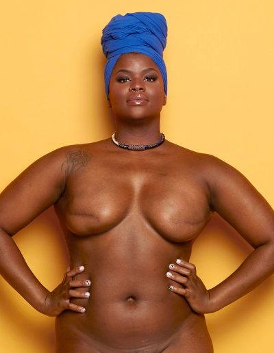 Ericka Hart in Essense with a blue headwrap