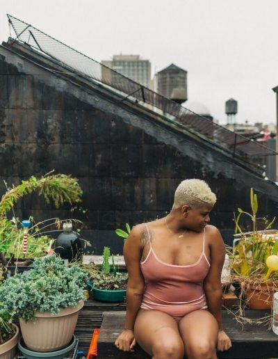 Ericka Hart on a rooftop surrounded by plants