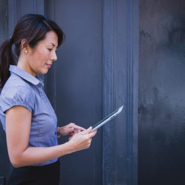 Business woman with a tablet working on quality control and team management.