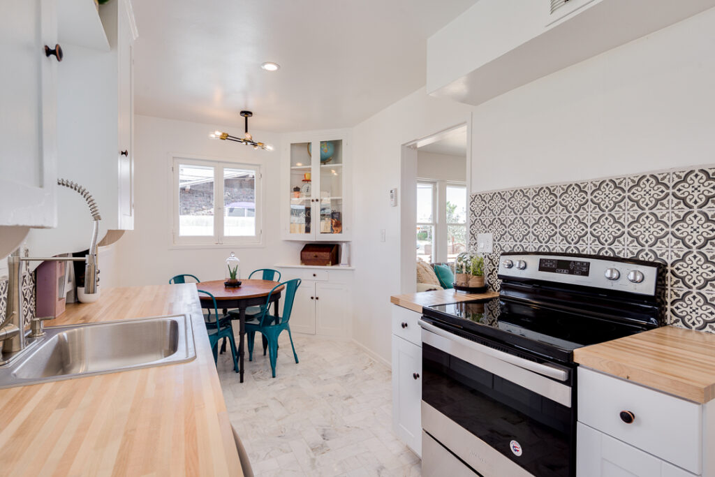 staged kitchen with small table and modern tiles