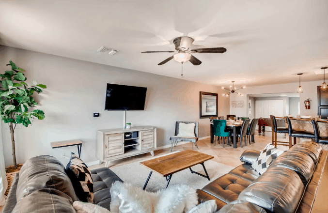 airbnb living room with large sectional couch and clean modern decor