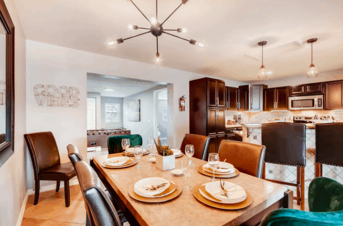airbnb dining room table with 6 chairs and modern lighting