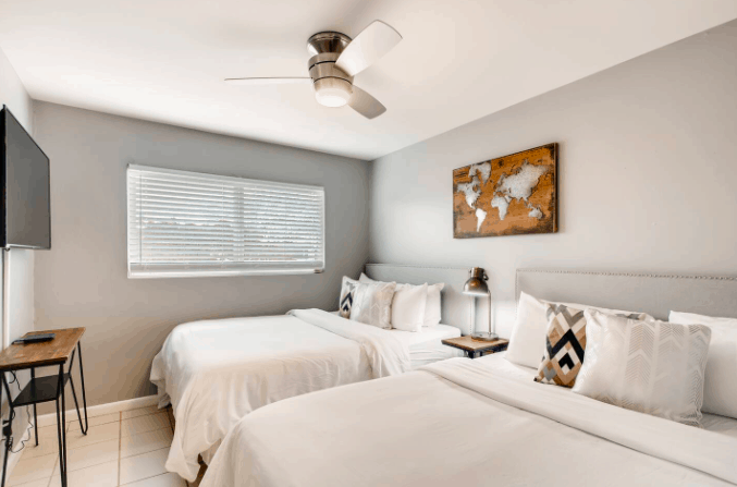 vacation rental bedroom with two queen beds and clean white linens