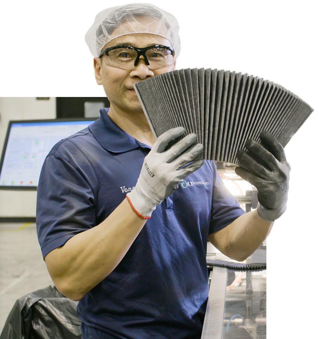 A man holding carbon filters