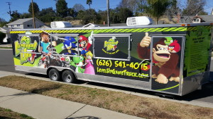 Level Up Game Truck exterior showing awesome video game characters and contact info