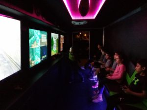 Purple Lighting Inside Showing Kids Having A Blast Inside Level Up Game Truck