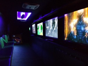 Interior photo showing ceiling infinity mirror, awesome game play from Call of Duty and other games played at birthday parties in Orange County or birthday parties in Los Angeles.