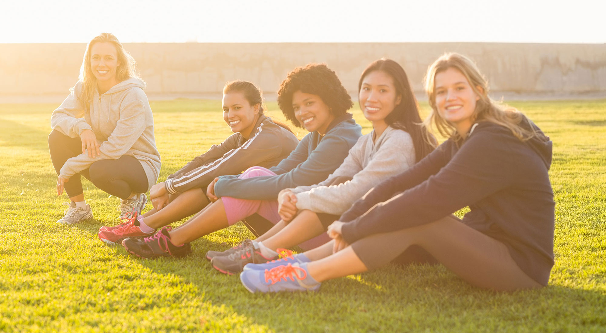 women-sitting-on-grass-cropped