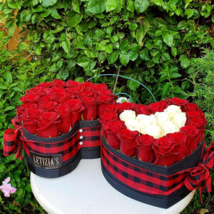 Red and White Roses in Black Heart Shaped Box
