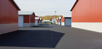 Outdoor view with gate of storage units