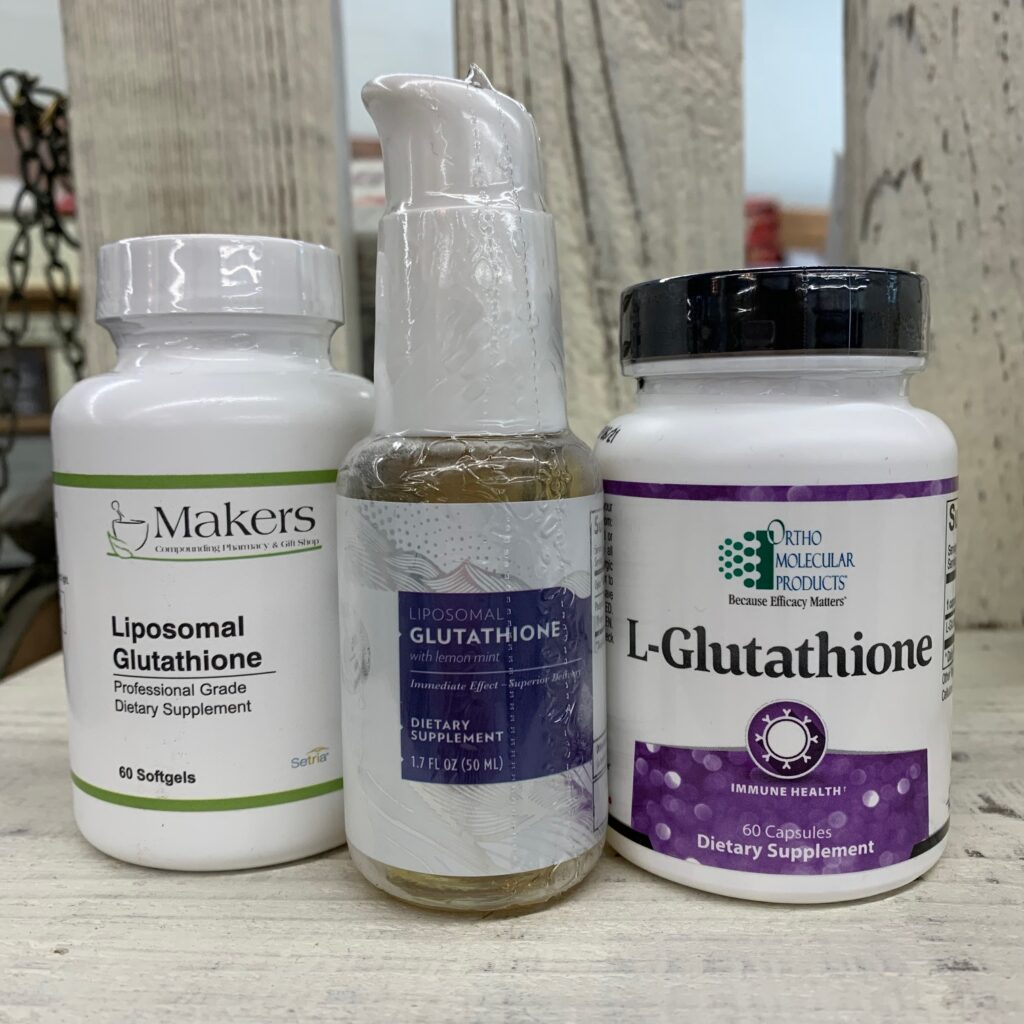 bottles of Liposomal Glutathione supplements. From left to right: by Makers Compounding Pharmacy, Quicksilver Scientific, and OrthoMolecular