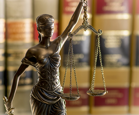 """Closeup image of brass statue of """"Blind Justice"""""""