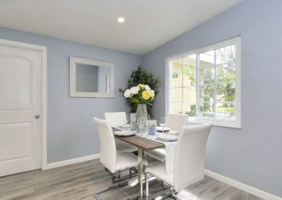 Staged home dining room in white and light blue at 1497 Cabrillo Ave Santa Clara CA