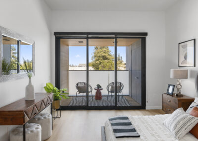 Bedroom Room with Private Balcony of a Staged Home at 2515 El Camino Real, Palo Alto, California