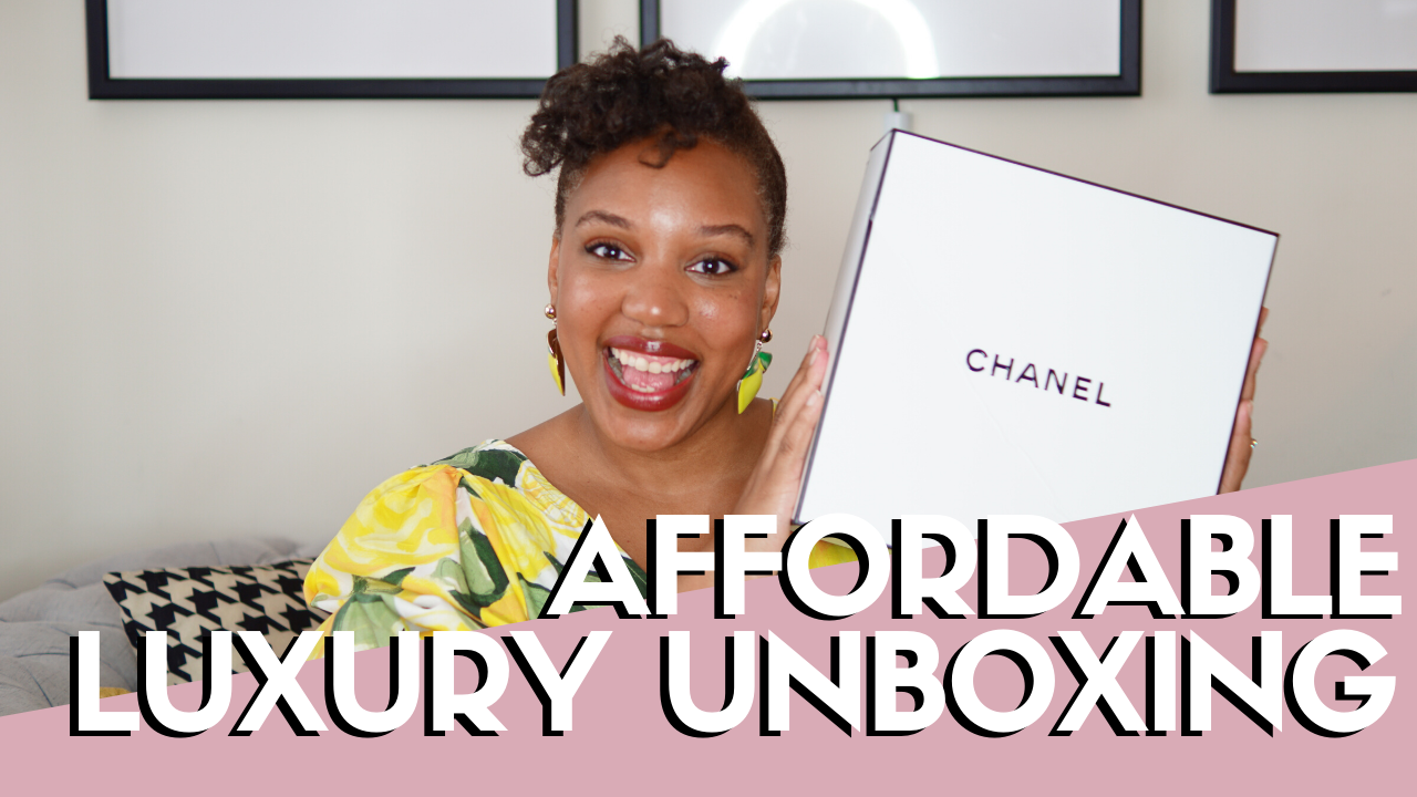 Affordable Luxury - Woman Holding Chanel Box