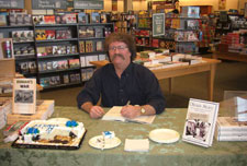 Barnes & Noble event in Waterloo, IA. Note half-eaten cake; one reader ate most of that by himself!  Wow!