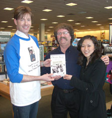 """At the Waterloo Barnes & Noble, friends and readers Dr. Samuel Gladden and Tracey Matteson.  Note Samuel is wearing a shirt with my picture on it and one of my favorite quotes:  """"Never get down in the mud with the hogs."""""""