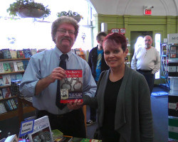 """Each year I participate in the """"Indies First"""" event, which is held to promote independent bookstores all across the country. This picture is of me and a new customer in Left Bank Books (St. Louis, MO), one of the finest bookstores ever."""
