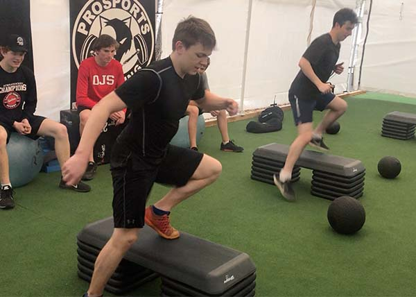 An image of athletes doing drills on a stepper