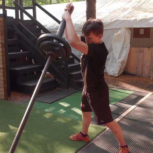 An image of an athlete doing a landmine weight exercise