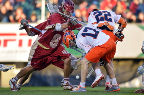 PHILADELPHIA, PA - MAY 25: Dylan Donahue #17 of the Syracuse University Orange goes for a loose ball while getting hit by Harley Brown #6 of the University of Denver Pioneers during a semifinal game of the 2013 NCAA Division I Men's Lacrosse Championships  at Lincoln Financial Field on May 25, 2013 in Philadelphia, Pennsylvania. Syracuse won 9-8. (Photo by Drew Hallowell/Getty Images)