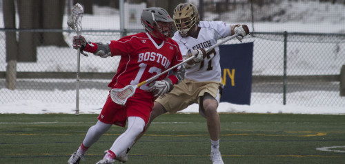 Corey Eppley, '16, a player on the men's lacrosse team, helped lead the defense in the game against Boston University. This was the first Patriot League game of the season and the Hawks won 10-9. (Liz Cornell/B&W photo)