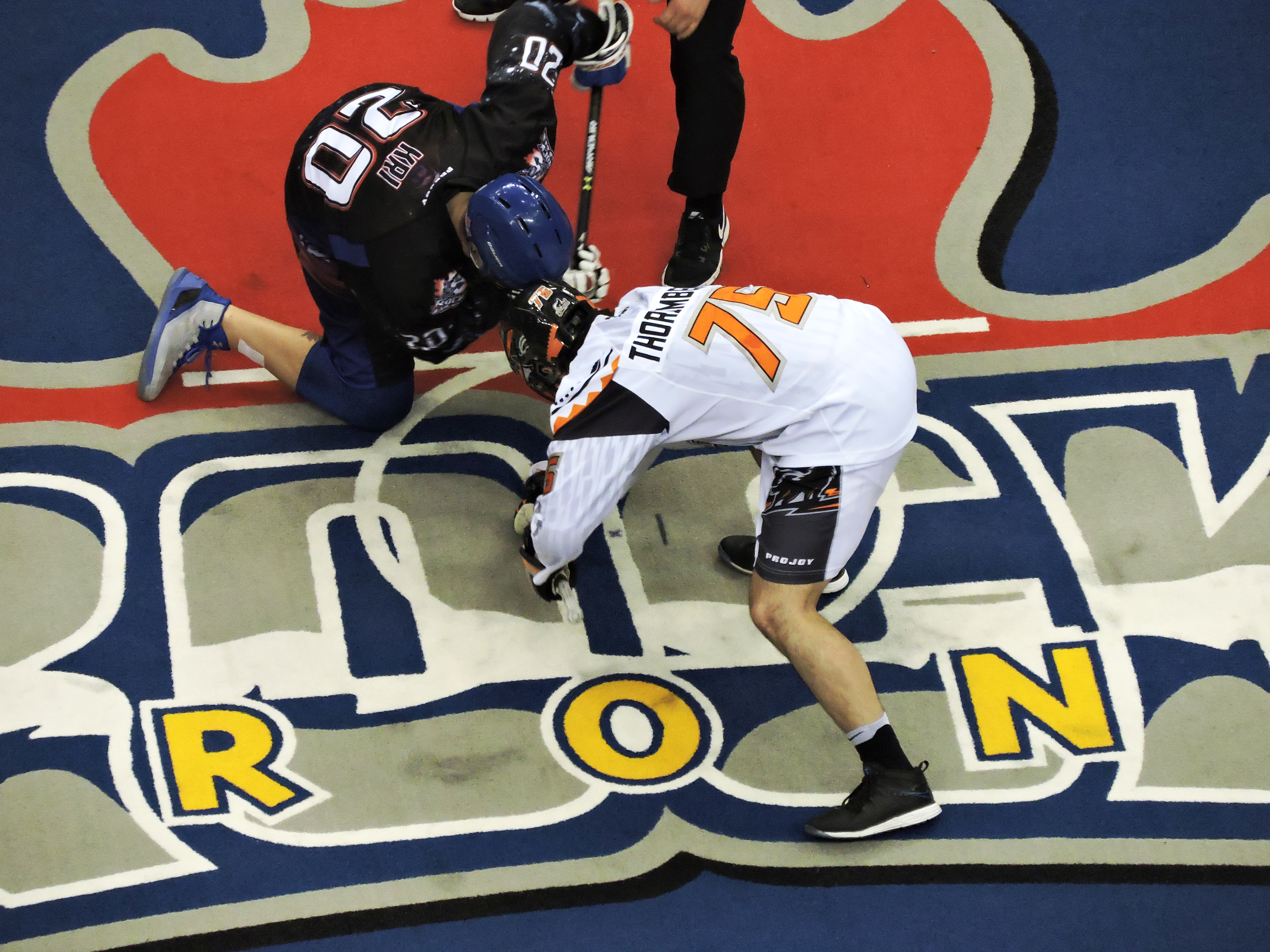Jay Thorimbert of the New England Black Wolves faces off against Bradley Kri of the Toronto Rock on March 3, 2017 at the Air Canada Centre. (Photo: Anna Taylor)