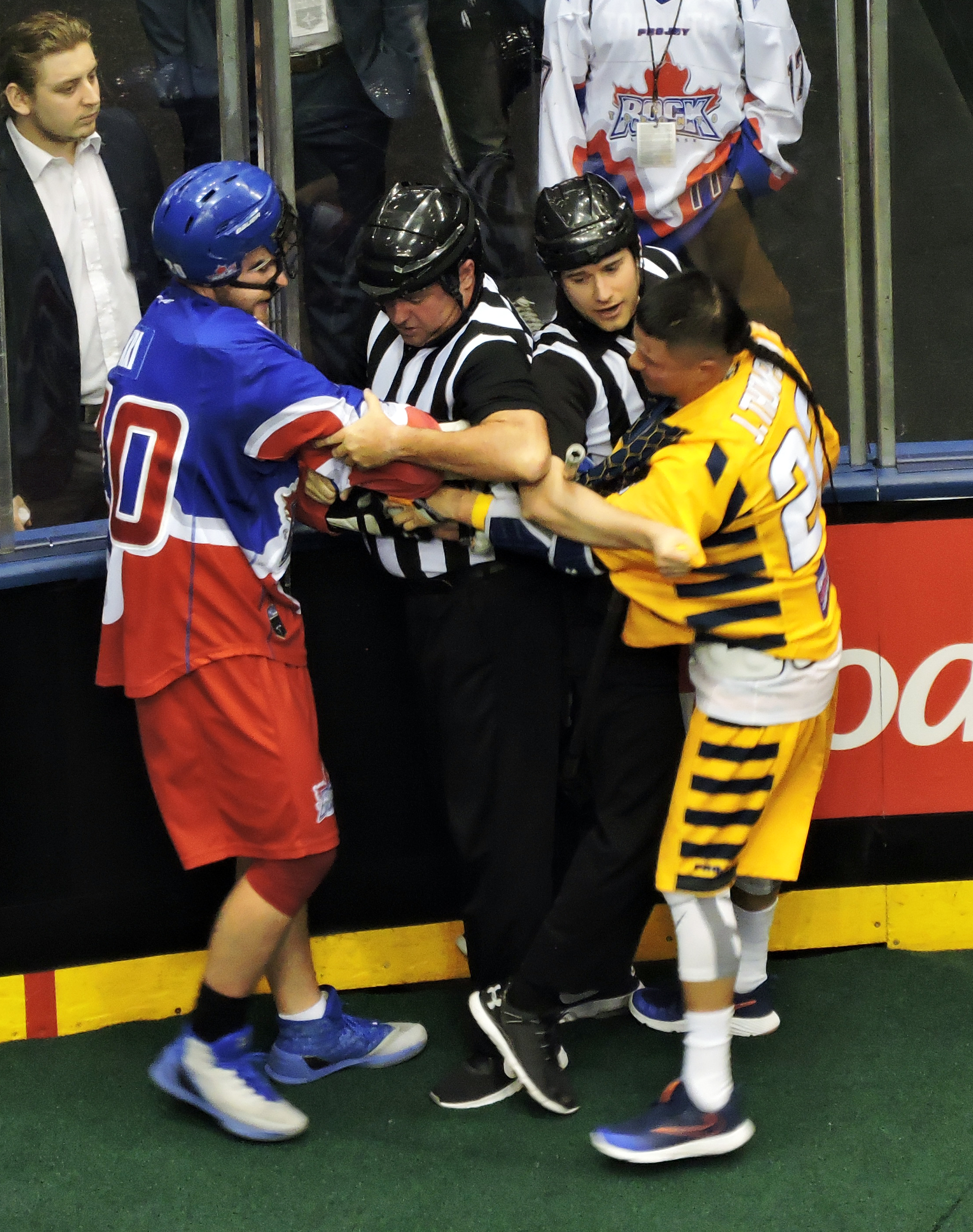 Bradley Kri of the Toronto Rock and Jerome Thompson of the Georgia Swarm exchange words at the end of the east division semi-final on May 13, 2017 at the Air Canada Centre. (Photo credit: Anna Taylor)