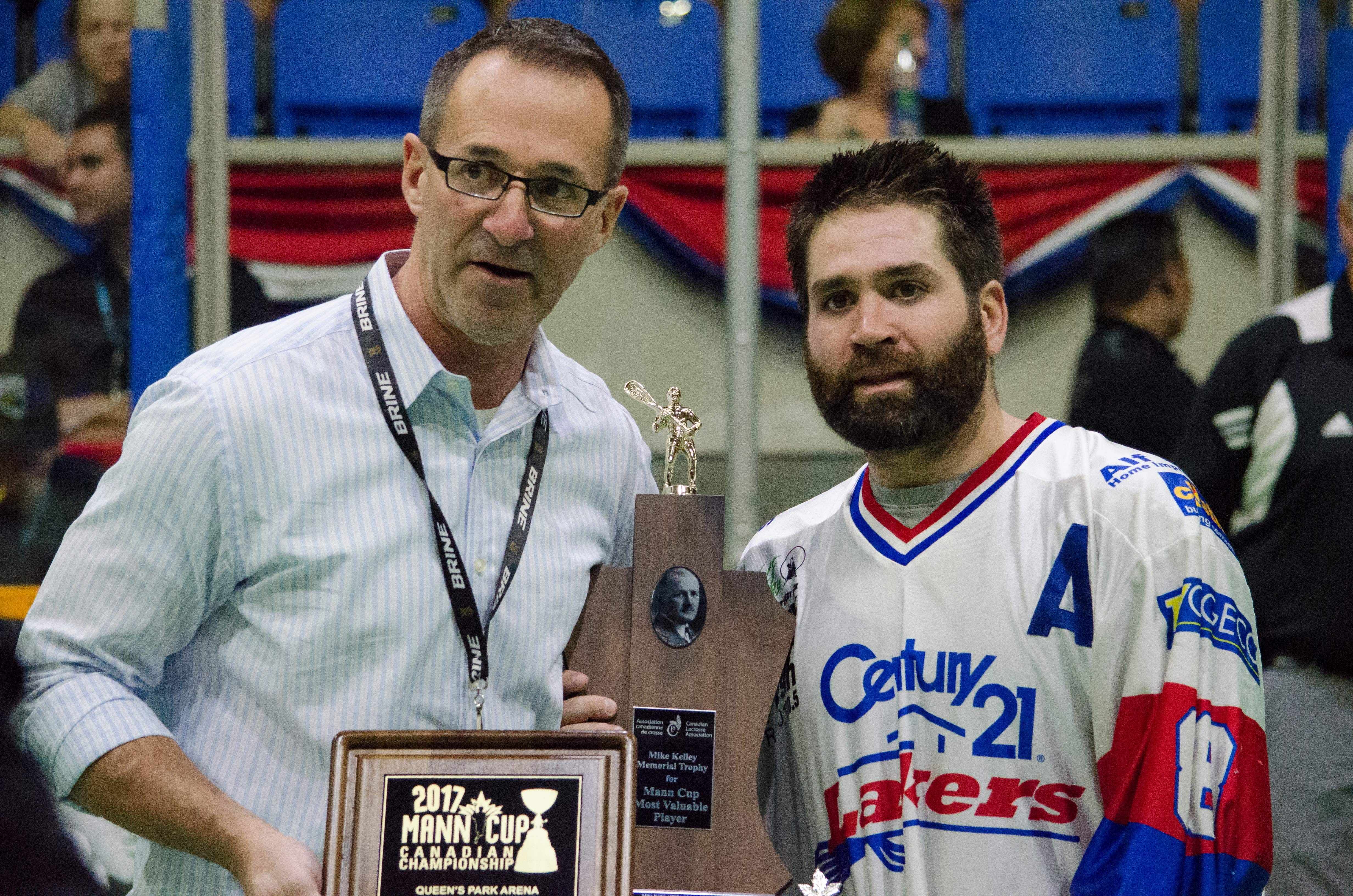 WLA commissioner Paul Dal Monte presents the Peterborough Lakers' Shawn Evans with the Mike Kelley award as Mann Cup MVP. (Photo credit: Kendall Taylor)