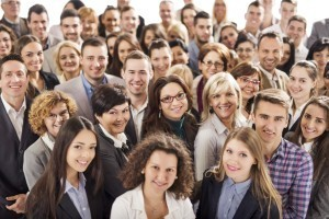 Crowd of happy business team looking at the camera. Isolated on white.