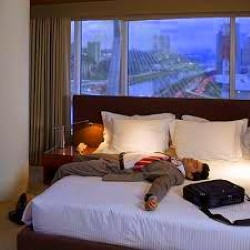Image of man laying on bed