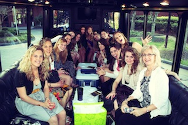 Group Of Ladies Having Fun in a CT limo party bus photo