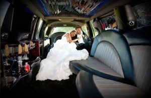 Image of bride and groom in a CT limousine