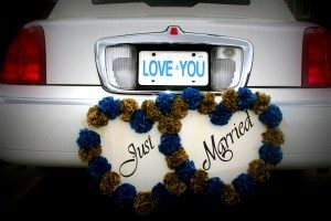 Image of back of white limousine with the words just married and a license tag that says love you