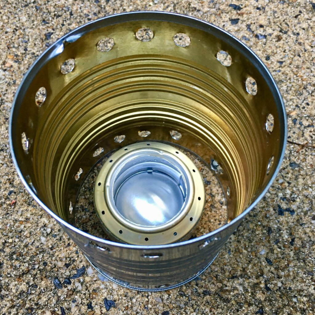 DIY denatured alcohol stove and a pot support made from a food can.