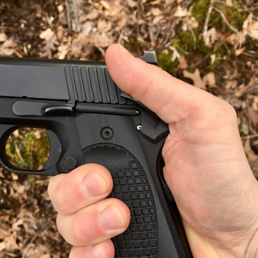 Thumb and palm placement for managing 1911 safeties.