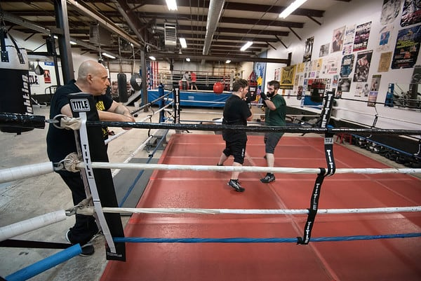 James Neiss/staff photographer  Niagara Falls, NY - Local boxing trainer Ray Casal of Casal's Boxing Club works with brothers Tyler and Dyllan Gantt.