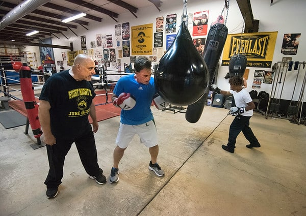 James Neiss/staff photographer  Niagara Falls, NY - Local boxing trainer Ray Casal of Casal's Boxing Club motivates John Rossi during his workout.