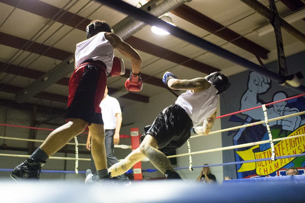 JOED VIERA/STAFF PHOTOGRAPHER Niagara Falls, NY- W. Dixon (red) knocks down Kyle Grace(blue) during a match at Casal's Boxing Gym.