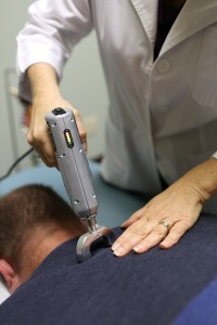 Chiropractic spinal adjustment with the Impulse iQ instrument