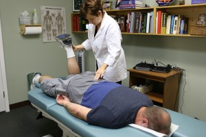 Dr. Marcy examining a chiropractic patient
